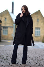 shot from the street,blogger,minimalist,black coat,jeans,coat,sweater,shoes