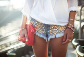 shorts,denim shorts,clutch,red clutch,white,white blouse,blouse,gold studs,studded shorts,gold,jewels,bag,jeans,shorts with spikes,spikes,studded denim shorts,boho jewelry,gold sequins