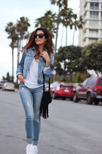 jacket white t-shirt ripped jeans white sneakers black handbag blogger