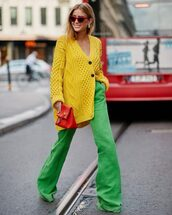 pants,flare pants,yellow,oversized cardigan,knitted sweater,button up,handbag,red sunglasses,cat eye,earrings