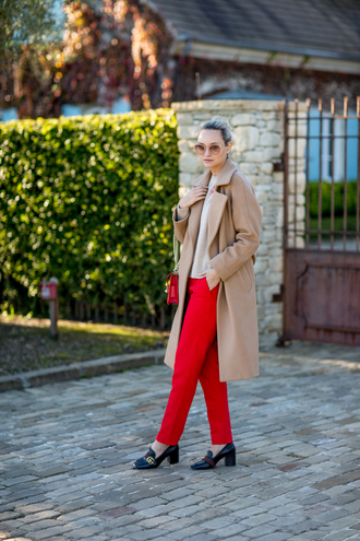late afternoon blogger coat sweater pants bag sunglasses shoes beige coat red pants loafers gucci shoes winter outfits