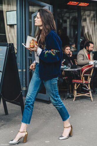 jacket velvet blue bomber jacket drawings faded jeans heels streetstyle outfit casual cool