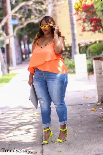 jeans ripped jeans orange top grey clutch oversized clutch blue jeans spaghetti strap mirrored sunglasses aviator sunglasses neon heels open toe heel plus size denim