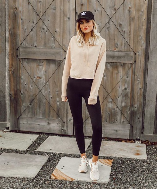 top cropped hoodie nude top leggings black leggings sneakers hoodie cap baseball cap sporty sportswear activewear
