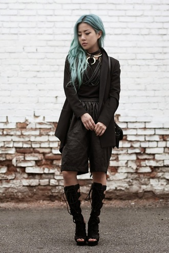 feral creature blogger blue hair black shorts gladiators black jacket