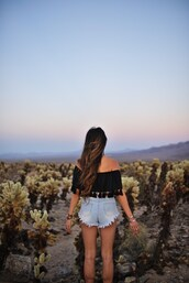 cuppajyo,blogger,top,shorts,shoes,jewels,bag,belt,off the shoulder,black top,black off shoulder top,tassel,black crop top,crop tops,off the shoulder top,frayed denim,denim shorts,short shorts,blue shorts,summer outfits,summer top,desert