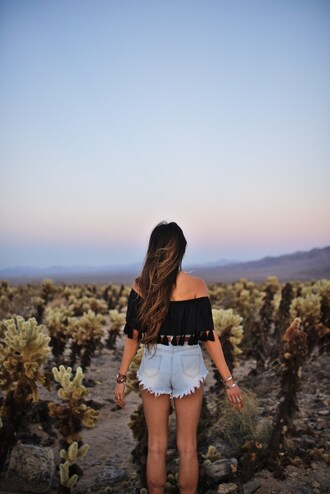 cuppajyo blogger top shorts shoes jewels bag belt off the shoulder black top black off shoulder top tassel black crop top crop tops off the shoulder top frayed denim denim shorts short shorts blue shorts summer outfits summer top desert