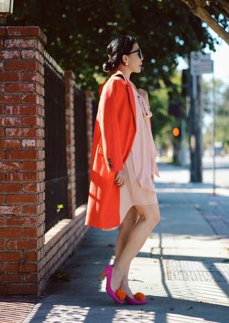 hallie daily blogger orange coat