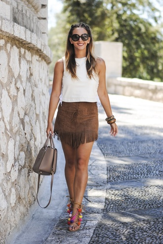 let's talk about fashion ! blogger sunglasses bag jewels fringes suede suede skirt white top mini skirt nude bag lace up heels crop tops white crop tops round sunglasses fringe skirt