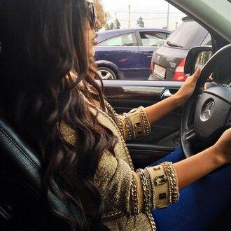 gold jacket luxury luxurious brunette diamands curls