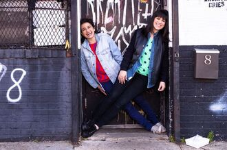 jacket ilana glazer abbi jacobson celebrity style celebrity actress black jeans blue jeans denim jeans denim jacket blue jacket black leather jacket leather jacket black jacket top red top blue top polka dots sneakers black sneakers white sneakers converse white converse