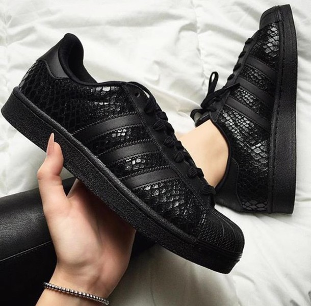 black superstar adidas gold logo