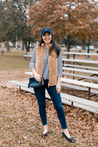 thecollegeprepster blogger hat jacket jeans t-shirt fall outfits cap vest striped top crossbody bag skinny jeans shoes flats