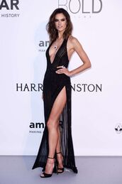 dress,slit dress,gown,prom dress,alessandra ambrosio,black dress,sandals,cannes,sexy,sexy dress,plunge v neck,plunge dress,shoes,backless dress