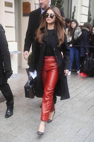 pants red pants selena gomez fashion week 2016 paris fashion week 2016 pumps streetstyle top
