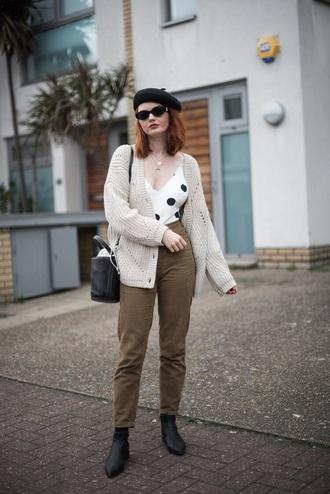 top cardigan grey cardigan pants green pants khaki pants boots beret sunglasses bag polka dots