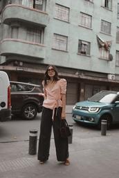 blouse,top,peach,peach top,wrap top,pants,wide-leg pants,sunglasses,bag