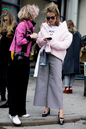 jacket,nyfw 2017,fashion week 2017,fashion week,streetstyle,pink jacket,t-shirt,white t-shirt,pants,printed pants,cropped pants,culottes,shoes,high heel loafers,loafers,sunglasses,black pants,sneakers,white sneakers,feminist tshirt