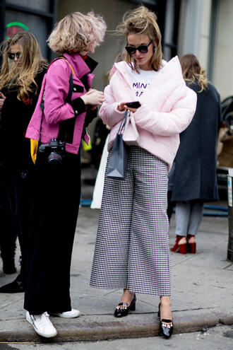 jacket nyfw 2017 fashion week 2017 fashion week streetstyle pink jacket t-shirt white t-shirt pants printed pants cropped pants culottes shoes high heel loafers loafers sunglasses black pants sneakers white sneakers feminist tshirt
