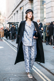 pants,london fashion week 2017,fashion week 2017,fashion week,streetstyle,blue pants,printed pants,pajama style,shirt,blue shirt,power suit,two piece pantsuits,sneakers,coat,black coat,black long coat,long coat,hat,black hat,fisherman cap
