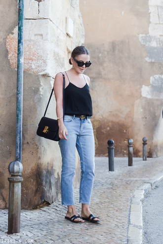 trini blogger jewels tank top belt top tumblr black top camisole sunglasses denim jeans blue jeans shoes slide shoes bag black bag