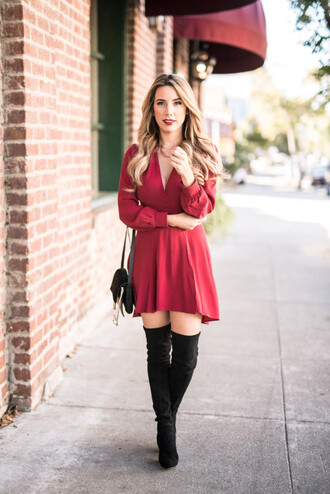 fashionborn blogger red dress thigh high boots black boots red mini dress mini dress fall dress fall outfits long sleeves long sleeve dress over the knee boots over the knee high heels boots shoulder bag v neck
