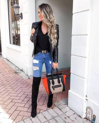 jacket black jacket top black top jeans blue jeans belt black belt shoes black shoes bag