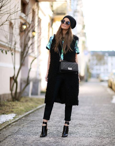 stylista blogger fluffy faux fur vest black pants black shoes top jacket pants shoes bag sequin shirt sequins black beanie black bag black fur vest