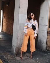 jeans,orange,wide-leg pants,sandal heels,bag,sunglasses