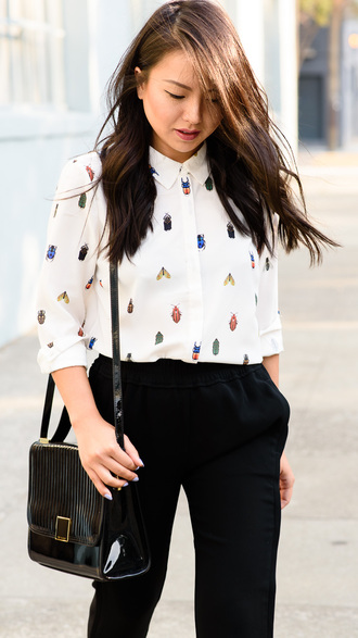 the fancy pants report blogger pants insects white shirt black bag patent leather bag shoulder bag shirt printed shirt black pants spring outfits patent bag
