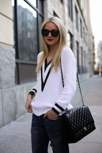 sweater clothes white black plunge v neck tumblr chanel jewelry bag round sunglasses sweatshirt jeans shirt sunglasses