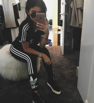 shoes adidas kylie jenner black leggings shirt top adidas originals black shoes fashion style kylie jenner sneakers silver zipper white soles pants white adidas tracksuit joggers tracksuit t-shirt black and white instagram shades kyiejenner stripes jumpsuit adida leggings addidas leggings kylie jenner dress workout leggings workout top workout tights sunglasses iphone blouse kardashians