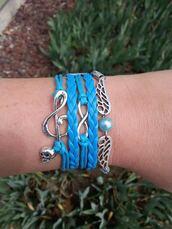 jewels,friendship bracelet,leather bracelet,charm bracelet,music symbol bracelet,skull bracelet,pearl bracelet,wings bracelet