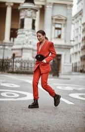 jacket,blazer,red blazer,pants,red pants,pantsuit,red pantsuit,two piece pantsuit,boots,black boots,bag,belt bag