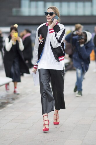 knitted top white white top mesh mesh top olivia palermo blogger celebrity celebrity style bomber jacket black bomber jacket leather pants red heels black and white satin bomber blue sunglasses white sweater sweater culottes palazzo pants black pants black leather pants celebrity work outfits leather culottes