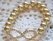jewels,fashion,bracelets,arm candy,infinity,rhinestones,infinity bracelet,cute,girly,gold,beaded,bead