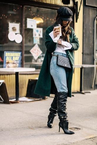 bag belt bag chanel blue jeans hat fisherman cap white shirt coat green coat chanel bag jeans shirt