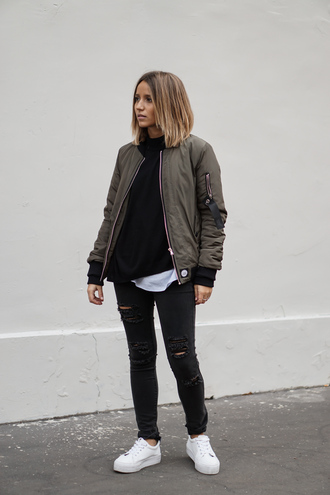 jacket black sweater green bomber jacket black ripped jeans white sneakers blogger