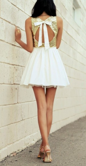 glitter dress gold bows white shimmer white dress bows skater dress backless dress backless pretty dress prom dress simple sequin dress gold sequins tutu skirt short dresses 2014 sparkly dress gold top tie back dress cream pinterest