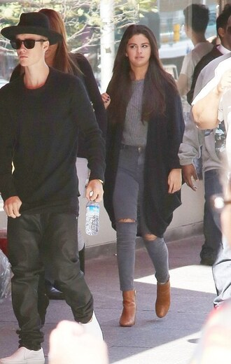 selena gomez ripped oversized cardigan grey jeans jeans