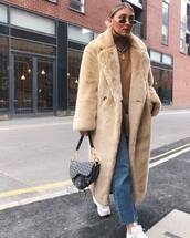 coat,faux fur coat,oversized coat,jeans,sneakers,handbag,turtleneck sweater,chain necklace,earrings,sunglasses