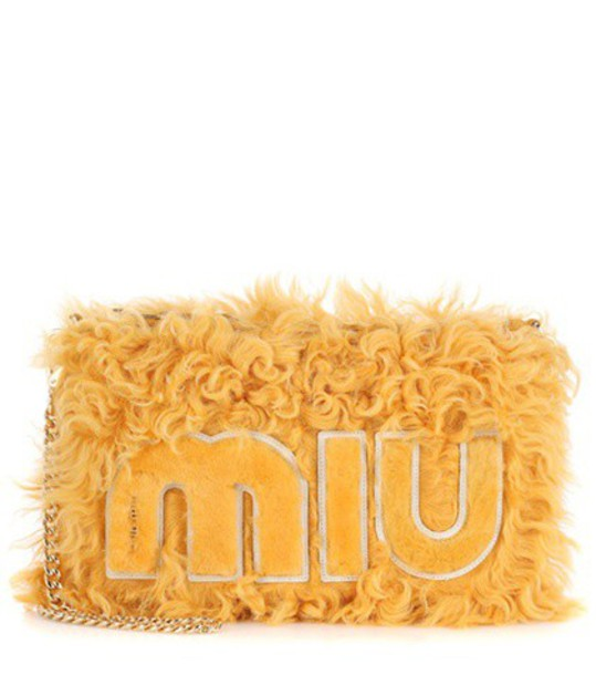 Miu Miu clutch yellow bag