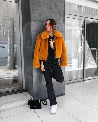 jacket black pants fur jacket faux fur jacket orange pants stripes sneakers white sneakers