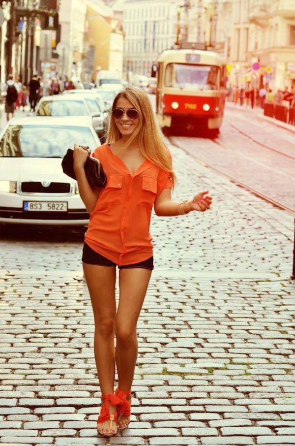 shirt orange shirt black shorts shorts bow heels orange shoes clutch sunglasses shoes