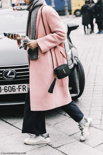 coat tumblr pink coat bag black bag tassel scarf grey scarf fashion week 2017 streetstyle pants black pants wide-leg pants stripes striped pants socks sneakers white sneakers