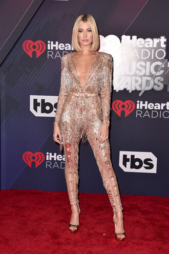 jumpsuit gown hailey baldwin sandals gold plunge neckline plunge v neck red carpet dress red carpet model off-duty i heart iheartradio shoes