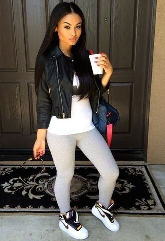 india westbrooks leather jacket grey sweatpants high top sneakers jacket leggings red lime sunday shoes