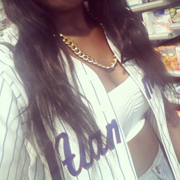 shirt baseball baseball shirt swag dope chain gold chain necklace girl sporty bandeux white white top pattern high waisted jeans high waisted jeans denim ootd casual chest gold jewelry jewels gold long hair curly hair weave real fake menswear tank top