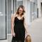 Summer wedding guest: black lace midi dress — bows & sequins