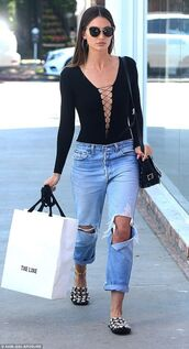 top,lace-up bodysuit,black bodysuit,lace up,bodysuit,jeans,ripped jeans,blue jeans,slide shoes,bag,black bag,shoulder bag,sunglasses,lily aldridge,model off-duty,model,celebrity